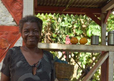 Haiti: Oxelia outside her Habitat home in Haiti which stood strong durign the 2021 earthquake.