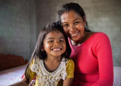 Bek Chan, Cambodia: Phun Sreyny & her daughter Sreyleap in the house that she helped build with Habitat.